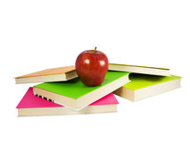 Apple in top of books Stock Photos