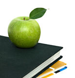 Apple on top of books Stock Images