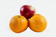 Apple on top. An apple sits on top of some oranges Stock Image