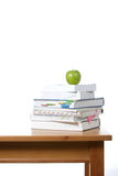 An apple on top of a stack of books Stock Photos