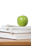 An apple on top of a stack of books Royalty Free Stock Photo