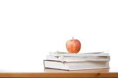 An apple on top of a stack of books Royalty Free Stock Image