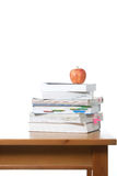 An apple on top of a stack of books Royalty Free Stock Photography