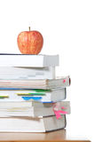 An apple on top of a stack of books Stock Photo