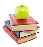 Apple on top of stack of old books Stock Photography