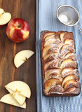 Apple-topped loaf cake. And apple Royalty Free Stock Photo