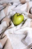 Apple on a towel Royalty Free Stock Photos