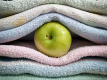Apple and towels Stock Image