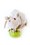 Apple with a toy. Green apple with a toy rat Stock Image