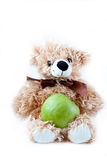Apple with a toy. Green apple with a toy bear Royalty Free Stock Images