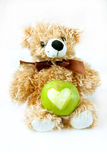 Apple with a toy. Green apple with a toy bear Royalty Free Stock Image