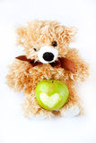 Apple with a toy. Green apple with a toy bear Royalty Free Stock Photography