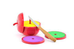 Apple toy fancy. Fancy toy apple shown sliced Royalty Free Stock Photos