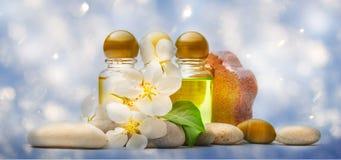 Apple tree flowers, stones and shampoo Royalty Free Stock Photo