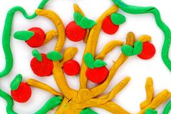 Apple tree made with plasticine on white paper. Royalty Free Stock Image