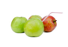 Apple with a tubule Royalty Free Stock Photos