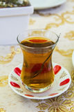 Apple Turkish tea in a traditional cup in a cafe Royalty Free Stock Images