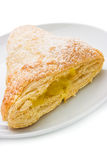 Apple turnover. With a tasty sweet apple filling oozing out of  flaky puff pastry and icing sugar sprinkled on top. Shallow depth of field Royalty Free Stock Image