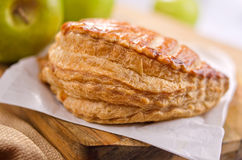 Apple Turnover. A freshly baked apple turnover with granny smith apples in the background Royalty Free Stock Photos