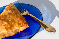 Apple Turnover with Fork. On blue glass plate Stock Image