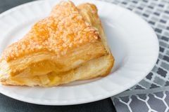 Apple turnover pastry on plate with gray napkin cloth Stock Images