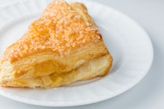 Apple turnover pastry on plate with white background Royalty Free Stock Image
