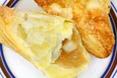 Apple turnover portion on plate Royalty Free Stock Image