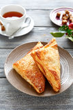 Apple  turnovers with black tea Stock Images