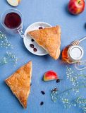 Apple turnovers with tea Stock Photos