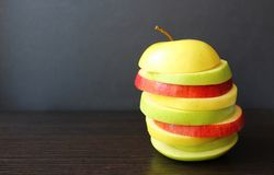 Apple two-color fresh juicy cut into slices royalty free stock photo