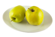 Apple. Two green apples on a plate Royalty Free Stock Photos