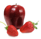 Apple with two strawberry Royalty Free Stock Photography