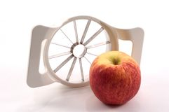 Apple und Apple-Schneidmaschine   lizenzfreie stockfotografie