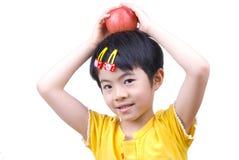 Apple und das kleine Mädchen Lizenzfreies Stockbild