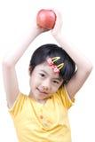 Apple und das kleine Mädchen Stockfotografie
