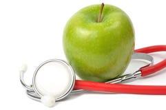 Apple und Stethoskop lizenzfreies stockfoto