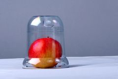 Apple Under Glass Royalty Free Stock Photos