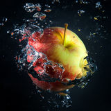 Apple is under water in a stream of air bubbles Stock Image