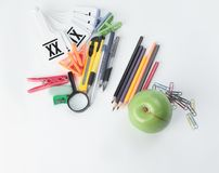 Apple and variety of school supplies on white background.photo with copy space Royalty Free Stock Photography