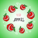 Apple Vector2. Hand-drawn red decorative apples with white hearts on the green background Royalty Free Stock Photos