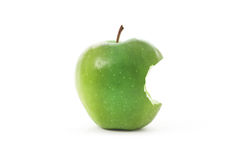 Apple verde com mordida Imagem de Stock Royalty Free
