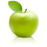 Apple verde con la hoja verde Imágenes de archivo libres de regalías