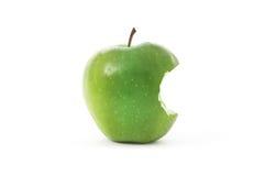 Apple verde con la mordedura Imagen de archivo libre de regalías