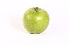 Apple verde en el fondo blanco fotografía de archivo libre de regalías