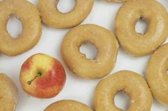 Apple Versus Donuts Royalty Free Stock Photos
