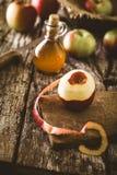 Apple vinegar on wood Stock Photos