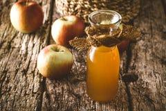 Apple vinegar on wood Royalty Free Stock Photo