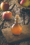 Apple vinegar on wood Royalty Free Stock Photo