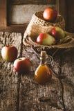 Apple vinegar on wood Royalty Free Stock Photography