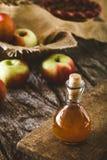 Apple vinegar on wood Stock Images
